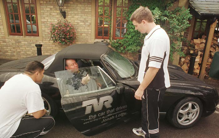 UNITED KINGDOM - OCTOBER 09: All Blacks Carl Hoeft and Andrew Mehrtens with Phil KingsleyJones, Jonah Lomu's manager look over Lomu's TVR sports car parked at the Pennyhill Country Club, Bagshot, Friday, base for the teams Rugby World Cup camp. (Photo by Ross Setford/Getty Images)