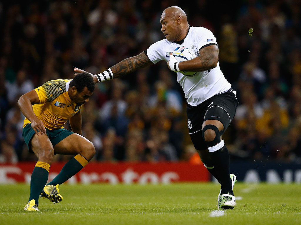 CARDIFF, WALES - SEPTEMBER 23: Nemani Nadolo of Fiji hands off Will Genia of Australia during the 2015 Rugby World Cup Pool A match between Australia and Fiji at the Millennium Stadium on September 23, 2015 in Cardiff, United Kingdom.  (Photo by Stu Forster/Getty Images)