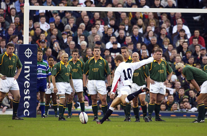 TWICKENHAM, ENGLAND - NOVEMBER 23: Jonny WIlkinson of England kicks at goal as the South African team look on during the Investec Challenge match between England and South Africa played at Twickenham in London, November 23, 2002. (Photo by Stephen Munday/Getty Images)